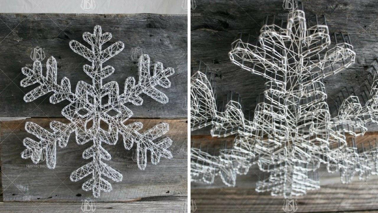 Сніжинка з ниток на дерев'яній основі